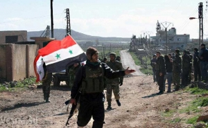 Syrian Army Raises Flag in Cradle of Protest Movement